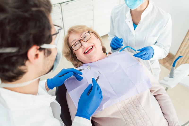 Senior patient smiling at routine dental appointment