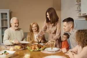 Man eating with dental implants at Thanksgiving dinner.