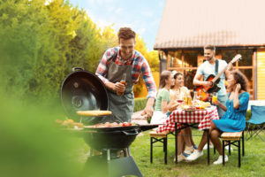 Group of friends at barbecue party outdoors